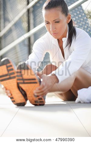 Woman Stretching Her Leg Muscles