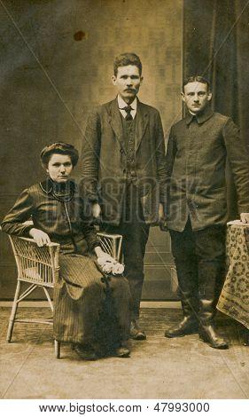 POLAND, CIRCA 1900 - vintage photo of two men and a woman in studio, Poland, circa 1900