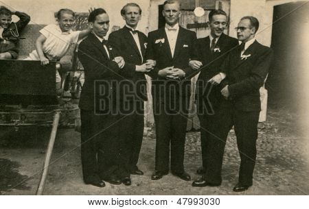RYCHTAL, POLAND, CIRCA 18 JUNE 1946 - vintage photo of groom with groomsmen, Rychtal, Poland, circa 18 June 1946