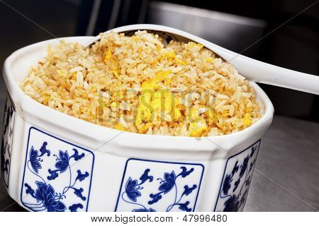 Chinese Egg Fried Rice In Traditional Porcelain Bowl.