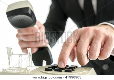 Businessman Hand Dialing A Phone Number