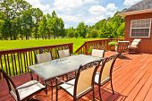 stock photo of lawn chair  - Large residential wooden backyard deck with furniture - JPG