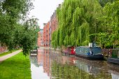 stock photo of isis  - Narrowboats on the Oxford Canal at Oxford - JPG