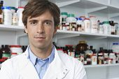 Portrait of confident male pharmacist in pharmacy