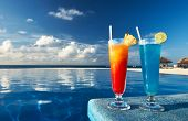 stock photo of curacao  - Cocktails near the swimming pool - JPG