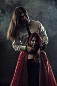 stock photo of scourge  - Red Riding Hood with furious Bad Wolf - JPG