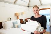 stock photo of housekeeping  - Portrait Of Hotel Chambermaid With Towels - JPG