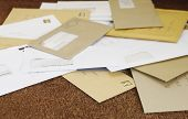 stock photo of piles  - Closeup of a pile of mail on doormat - JPG
