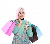 image of fitri  - Portrait of a beautiful young muslim woman in a holding in her hands a few shopping bags - JPG