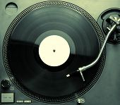 stock photo of view from space needle  - Top view of old fashioned turntable playing a track from black vinyl - JPG