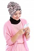 picture of fitri  - Portrait of beautiful muslim woman texting with her smartphone isolated over white background - JPG