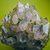 stock photo of crystallography  - precious stones crystals on display on green - JPG
