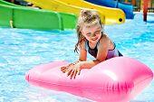 image of inflatable slide  - Child on water slide at aquapark - JPG