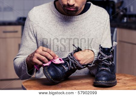 Man Is Polishing His Boots
