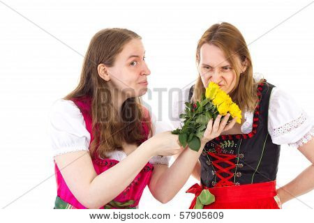 Two Women In Dirndls With Roses