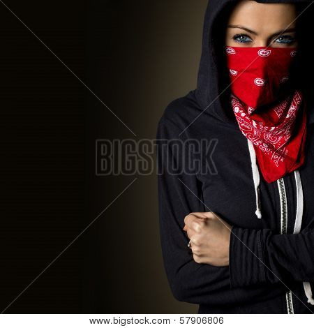 girl hiding behind a red bandanna