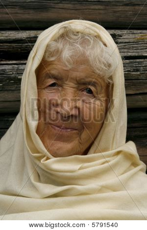 Charming Old Woman Wrapped In A Beige Scarf