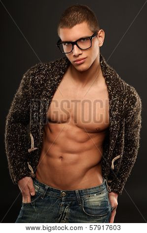 Handsome Athletic Young Man In The Unbuttoned Sweater
