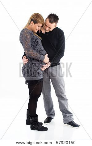 Young Pregnant Woman And Loving Father Together In The Studio On A White Background