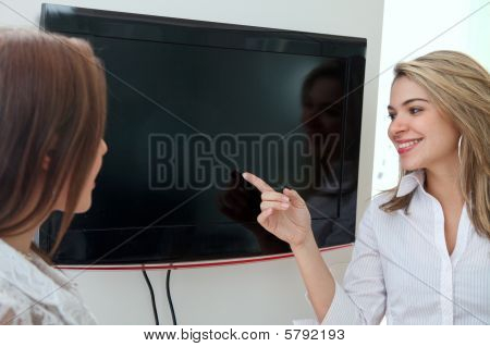 Business Woman Pointing At A Screen