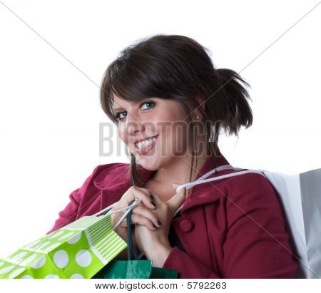 Young woman holding shopping bags; isolated on white