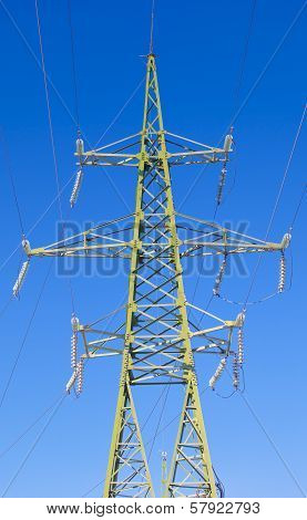 High voltage tower on a blue sky background