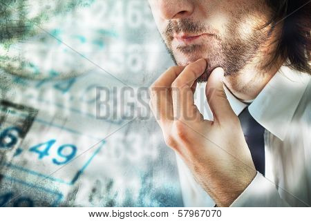 Businessman Thinking About Figures