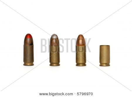 Row of three 9mm Parabellum cartridges and spent case isolated