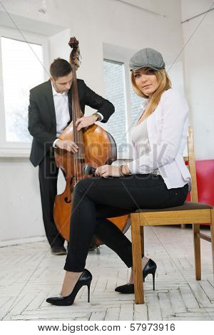 While Man Play Contrabass Woman