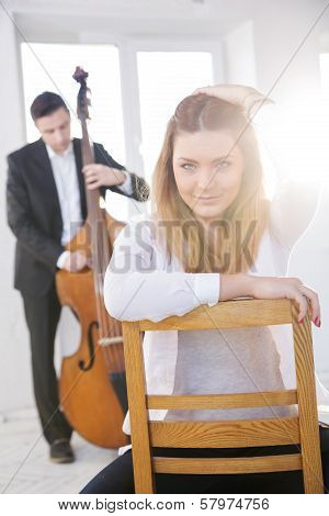 Woman Backwards On Wooden Chair Fondled Hairs