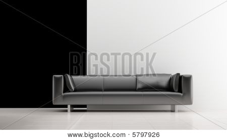 Black couch on a blank wall.