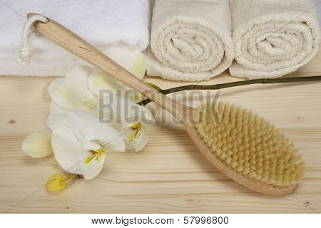 Bath Brush And Towels On A Tabletop Of Spruce Wood