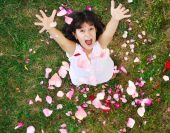 Happy Beautiful Girl On Ground With Rose's Petals