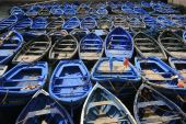 image of flatboat  - Blue fishing boats pressed together in Essaouira port Morocco - JPG