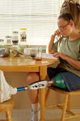 image of amputee  - Amputee woman studying herbal teratments with herbal tea - JPG