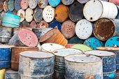 stock photo of bio-hazard  - old empty barrels containing hazardous chemicals - JPG