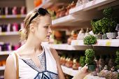 Attractive woman choosing potted plants
