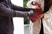 stock photo of yanks  - A woman trying not to let a man take her bag - JPG