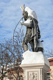 image of stockade  - Snow covers the upper portion of Lawrence the Indian a landmark statue in the Stockade section of Schenectady New York - JPG
