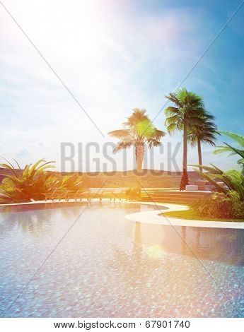 Beautiful landscaped tropical turquoise blue swimming pool with a curving wall leading to palm trees under a sunny blue sky