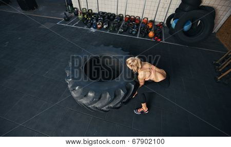 Young Female Flipping Heavy Tire
