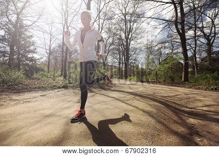 Young Woman Running Outdoors In Forest