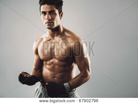 Muscular Fitness Model On Grey Background