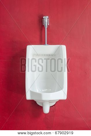 White Urinal On Red Wall