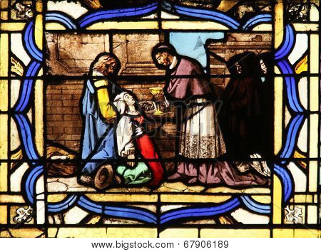 PARIS, FRANCE - NOV 11, 2012: Saint Charles Borromeo, stained glass. Church of St-Germain-l'Auxerrois founded in the 7th century, was rebuilt many times over several centuries.