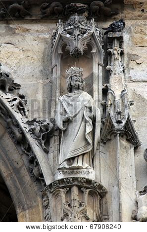 PARIS, FRANCE - NOV 11, 2012: Saint Charlemagne statue, Church of St-Germain-l'Auxerrois founded in the 7th century, was rebuilt many times over several centuries.