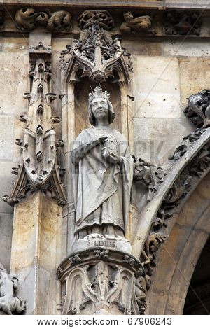 PARIS, FRANCE - NOV 11, 2012: Saint Louis statue, Church of St-Germain-l'Auxerrois founded in the 7th century, was rebuilt many times over several centuries.