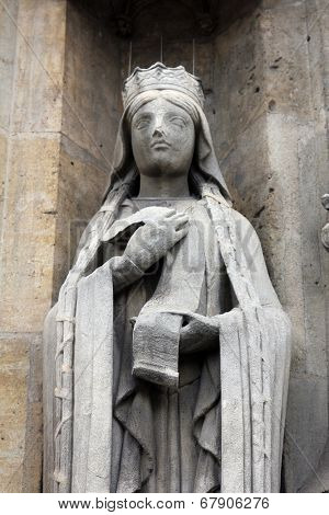 PARIS, FRANCE - NOV 11, 2012: Saint Clotilde statue, Church of St-Germain-l'Auxerrois founded in the 7th century, was rebuilt many times over several centuries.