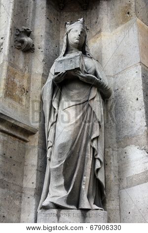 PARIS, FRANCE - NOV 11, 2012: Saint Joan of Valois statue, Church of St-Germain-l'Auxerrois founded in the 7th century, was rebuilt many times over several centuries.