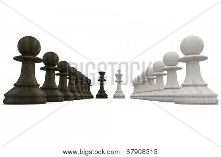 Wooden chess pieces facing off on white background